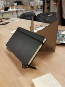 Laser cut tablet stand 1: with a book